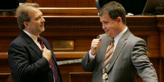 FILE - In this Thursday, May 21, 2009 file photo, Sen. Lee Bright, R-Spartanburg, right, holds onto the microphone as Sen. Br