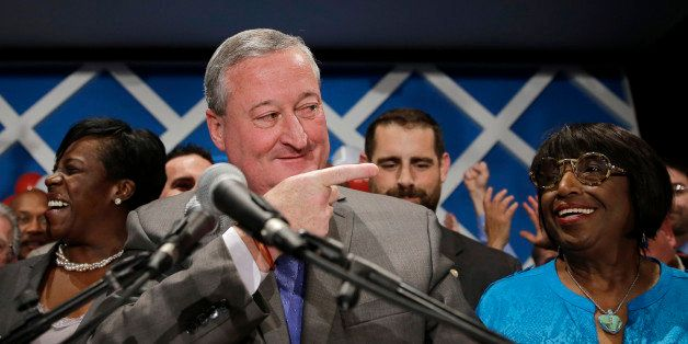 Democratic mayoral candidate and former City Councilman Jim Kenney, center, gestures onstage after winning the primary electi
