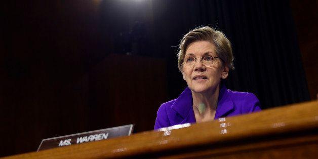 Senate Banking Committee member Sen. Elizabeth Warren, D-Mass., listens to testimony on Capitol Hill in Washington, Tuesday,