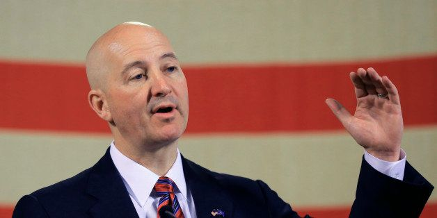 Neb. Gov. Pete Ricketts gestures during a news conference in Lincoln, Neb., Wednesday, May 20, 2015. Gov. Ricketts voiced his
