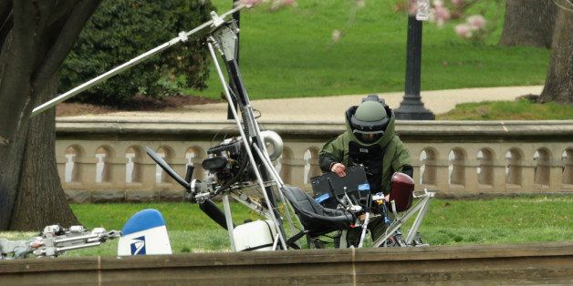 WASHINGTON, DC - APRIL 15:  A member of the U.S. Capitol Police Bomb Squad works to check and secure a gyrocopter that landed