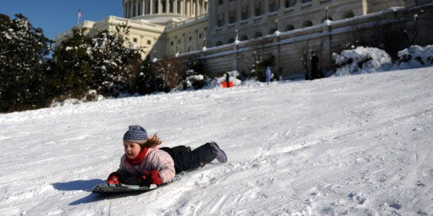Children sled down Capitol Hill in Washington, DC on February 8, 2010 as the District of Columbia and the mid-Atlantic region