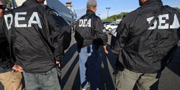 "DEA agents wait for the arrival of Jamaican gang leader Christopher ""Dudus"" Coke From Westchester County Airport, Thursday, J"