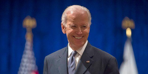 Vice President Joe Biden smiles as he arrives to speak to the University of Notre Dame Leaders Symposium, Tuesday, April 14,