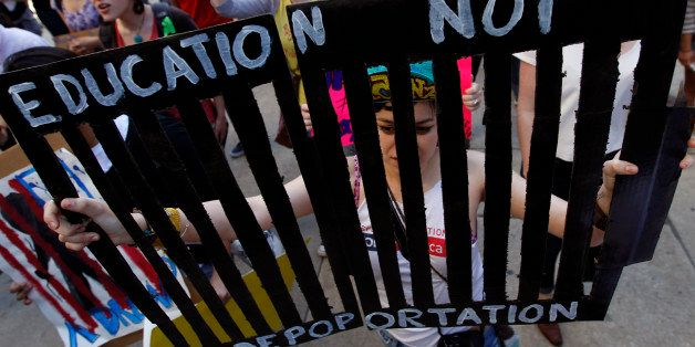 Jovanna Hernandez carries a sign during a protest march in support of undocumented youth, which concluded in front of the U.S