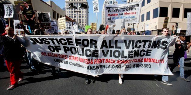 Protestors calling for the end of police brutality marched through downtown Sacramento, Calif., Tuesday, Oct. 22, 2013.  Call