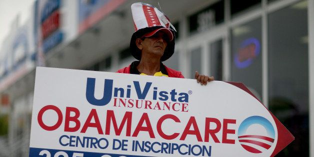 MIAMI, FL - FEBRUARY 05:  Oreste Alvarez  holds a sign directing people to UniVista Insurance company where they can sign up