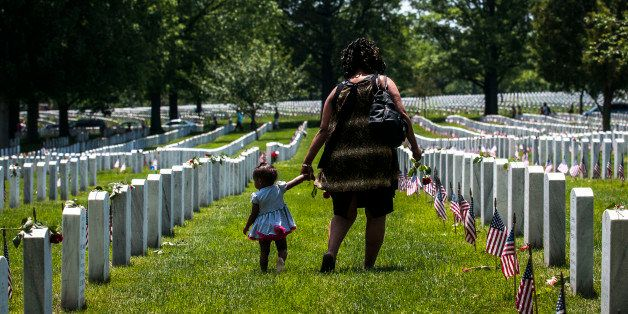 ARLINGTON, VA - MAY 25:   A mother and daughter stand in Section 60 on Memorial Day at Arlington National Cemetery on May 25,