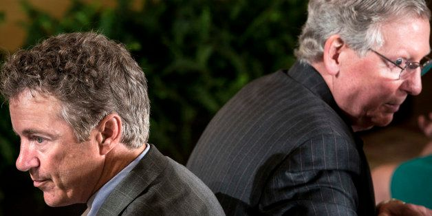 Senator Rand Paul(L) R-KY and Senate Minority Leader Senator Mitch McConnell (R-KY) wait for an event in the East Room of the