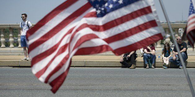 People watch motorcyclists during Rolling Thunder on May 24, 2015 in Washington, DC, as the US marks Memorial Day, May 25. Th