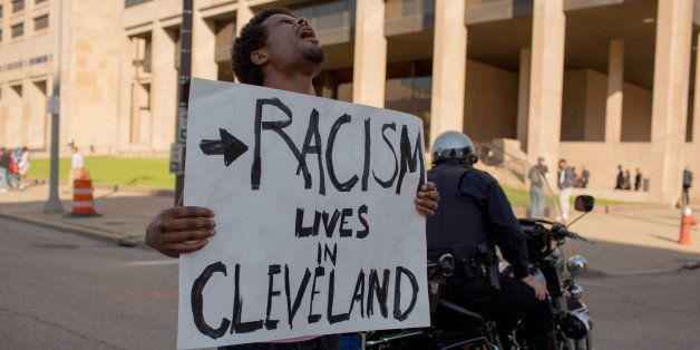 CLEVELAND, OH - MAY 23: Tanis Quach, of Cleveland, protests in front of the Justice Building. People take to the streets and
