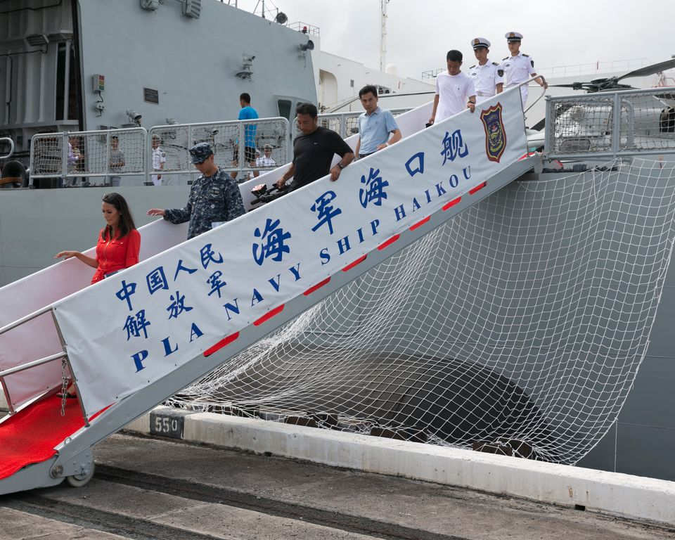 Members of the media and visitors disembark from the Chinese People's Liberation Army Navy ship Haikou, Saturday, July 5, 2