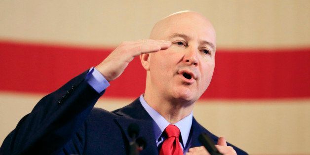 Nebraska Gov. Pete Ricketts speaks at a news conference after delivering his first State of the State address to lawmakers, T