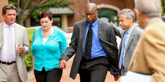 Former CIA officer Jeffrey Sterling, center, accompanied by his wife Holly, and his attorney, arrives at the U.S. District Co