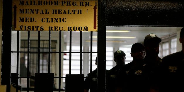 Rikers Island emergency services personnel walk through one of many gates inside the jail's juvenile detention facility, Thur