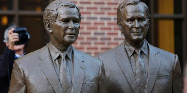 Statues of former Presidents George W. Bush, left and George HW Bush are seen during a tour of the George W. Bush Presidentia