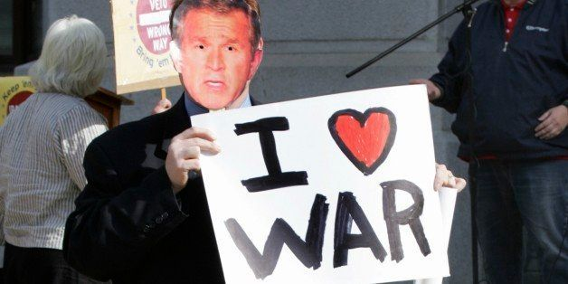 A man wearing a George Bush mask walks through the courtyard of Philadelphia's City Hall during a protest against the war in