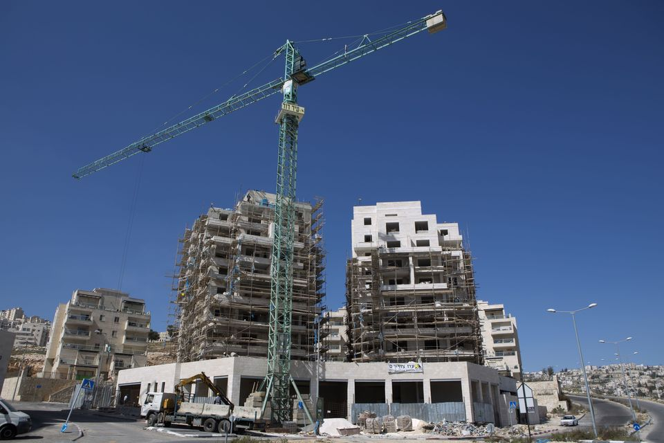 Labourers work at a housing construction site in the Israeli settlement of Har Homa in east Jerusalem on February 27, 2013.
