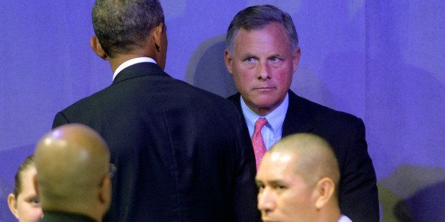 CHARLOTTE, NC - AUGUST 26:  U.S. Senator Richard Burr (R-NC), looks at President Barack Obama following his speech at the Ame