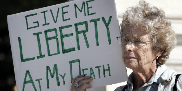 Ruth Gallaid from Eugene, Or., who supports physician assisted suicide, protests in front of the Supreme Court Wednesday, Oct