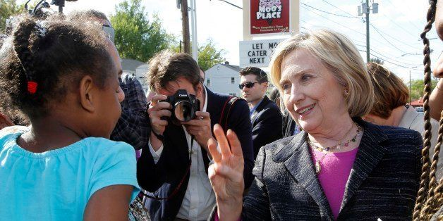 Democratic presidential candidate Hillary Rodham Clinton talks with customers during a stop for ice cream at Moo's Place, Fri