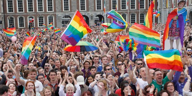 Yes supporters react at Dublin castle, Ireland, Saturday, May 23, 2015. Ireland has voted resoundingly to legalize gay marria