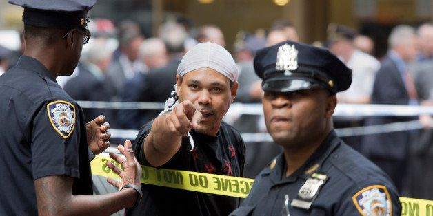 A witness talks with police at a Manhattan crime scene, Wednesday, May 13, 2015, in New York, after a man apparently wielding