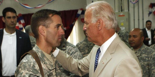 U.S. Vice President Joe Biden, right, talks with his son, U.S. Army Capt. Beau Biden (L), at Camp Victory on the outskirts of
