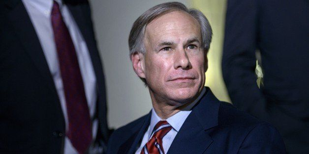 Texas Governor-Elect Greg Abbott (R-TX) listens to questions from the press after a meeting at the White House December 5, 20