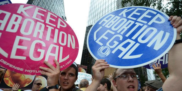 Abortion rights activists shout slogans on day two of the  Democratic National Convention (DNC), in Charlotte, North Carolina