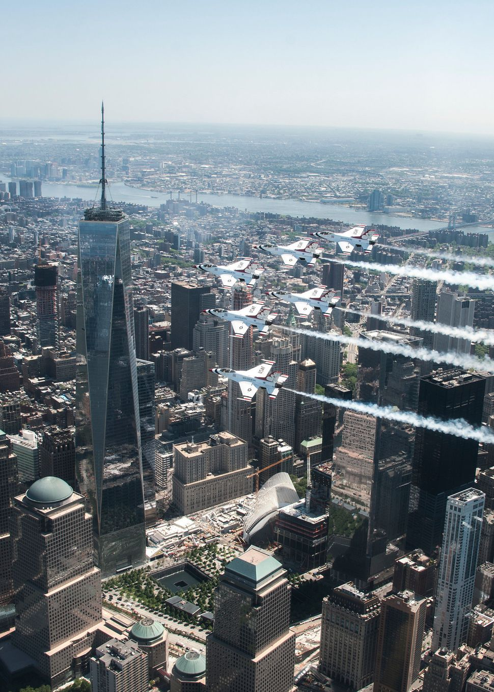 The Thunderbirds Delta formation flies by One World Trade Center during a photo chase mission in New York City May 22, 2015.