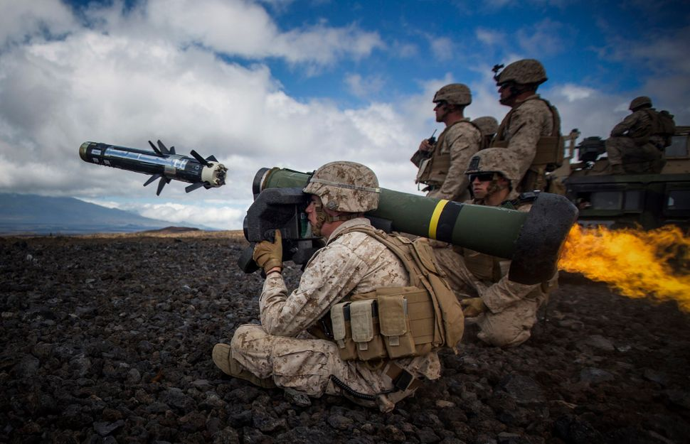"A U.S. Marine attached to Weapons Company, 1st Battalion, 3rd Marine Regiment - ""The Lava Dogs"" fires a Javelin at a simulate"