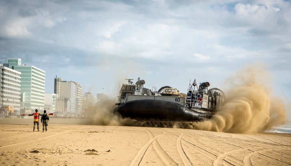 Landing Craft, Air Cushion (LCAC) 60 lands on the beach in Virginia Beach, Virginia, for the 2015 Patriotic Festival on May 2