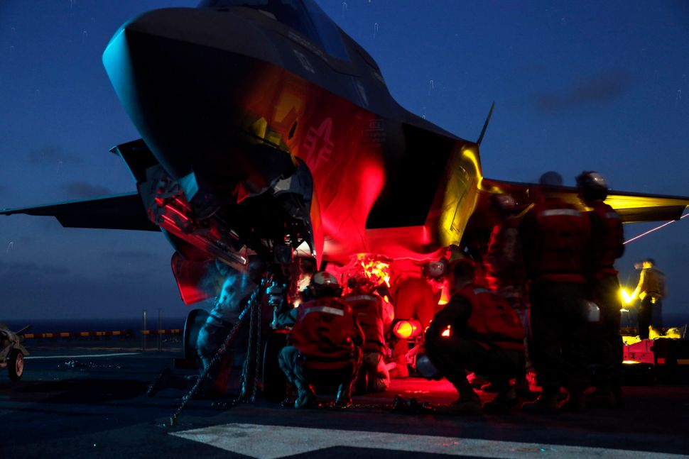 USS Wasp (LHD-1), At Sea- Marines load ordnance onto an F-35B Lightning II during Operational Testing 1 aboard USS Wasp at se
