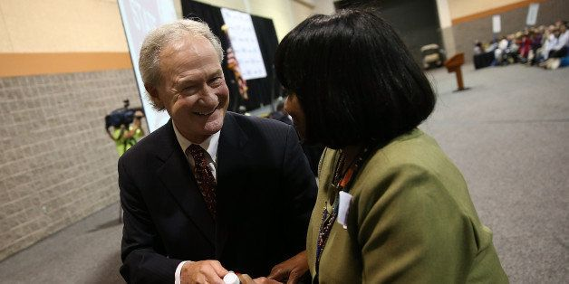 COLUMBIA, SC - APRIL 25:  Potential Democratic presidential candidate former Sen. Lincoln Chafee (D-RI) greets a member of th