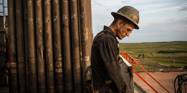 WATFORD CITY, ND - JULY 28:  Ray Gerish, a floor hand for Raven Drilling, works on an oil rig drilling into the Bakken shale