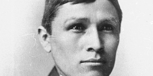 A Navajo named Tom Torlino is photographed in 1890 after completing a three-year course at the Carlisle Indian School, in Car