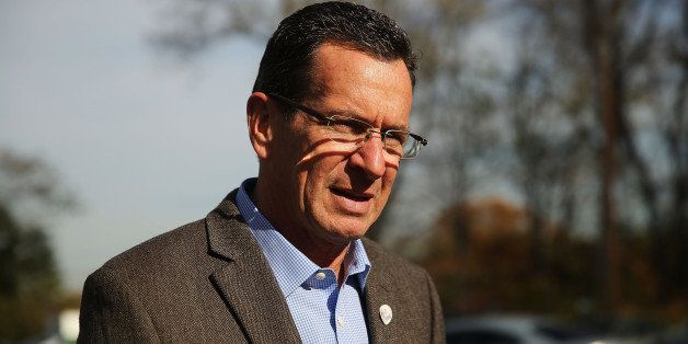 BRIDGEPORT, CT - NOVEMBER 04:  Democratic Connecticut Governor Dan Malloy stops at a polling station on November 4, 2014 in B