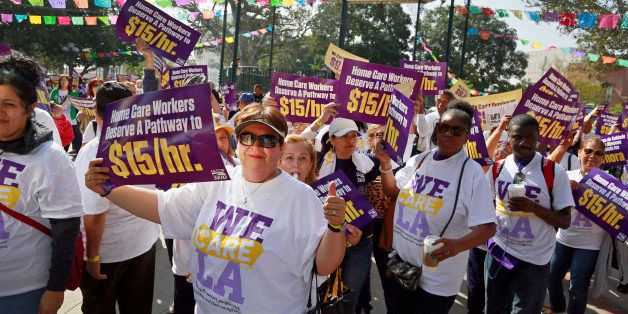 Home health care workers rally for better wages at Olvera Street, Tuesday, April 14, 2015, in Los Angeles. The union represen