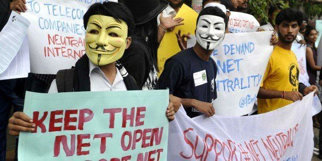 Indian activists wear Guy Fawkes masks as they hold placards during a demonstration supporting 'net neutrality' in Bangalore