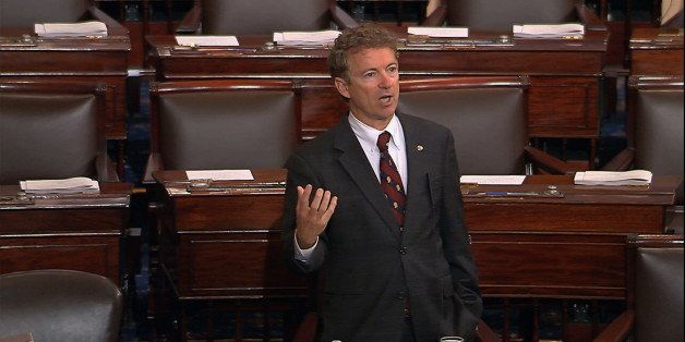 In this image from Senate video, Sen. Rand Paul, R-Ky., and a Republican presidential contender, speaks on the floor of the U.S. Senate Wednesday afternoon, May 20, 2015, at the Capitol in Washington, during a long speech opposing renewal of the Patriot Act. Paul claimed he was filibustering, but under the Senate rules, he wasn't. (Senate TV via AP)