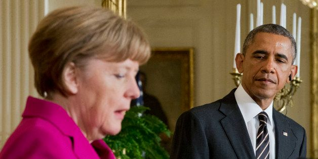 President Barack Obama, right, listen to German Chancellor Angela Merkel, left, during their joint news conference in the Eas