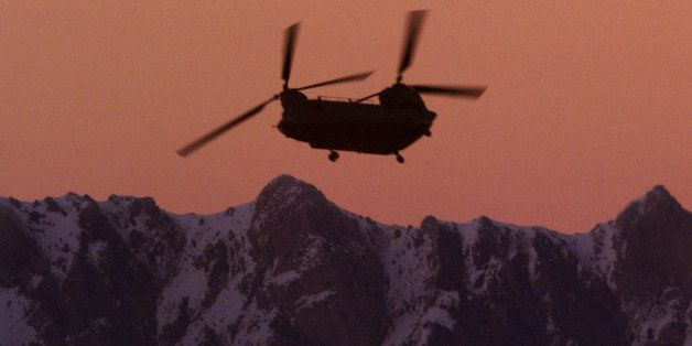 A U.S. CH-47 Chinook helicopter flies over the Paktia province town of Gardez, Afghanistan in this March 5, 2002  photo.  The