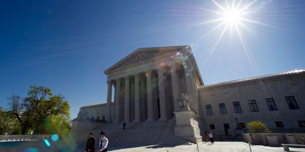 Supreme Court police officers walk on the plaza in front of the Supreme Court in Washington, Tuesday, April 28, 2015. The Sup