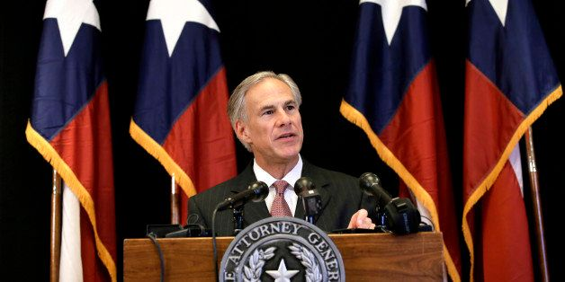 Texas Attorney General Greg Abbott makes a statement during a news conference, Monday, Nov. 4, 2013, in Dallas. Abbott announ