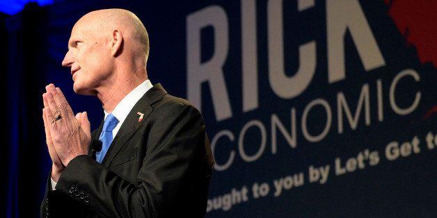 Florida Gov. Rick Scott gives the opening remarks during Rick Scott's Economic Growth Summit in Lake Buena Vista, Fla., Tuesd