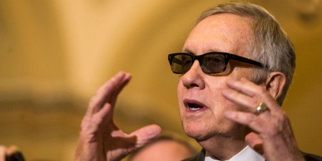 Senate Minority Leader Harry Reid of Nev. speaks to reporters on Capitol Hill in Washington, Tuesday, May 5, 2015, following