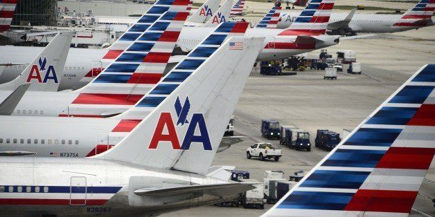 American Airlines passenger planes are seen on the tarmac at Miami International Airport in Miami, Florida, June 8, 2015.   A