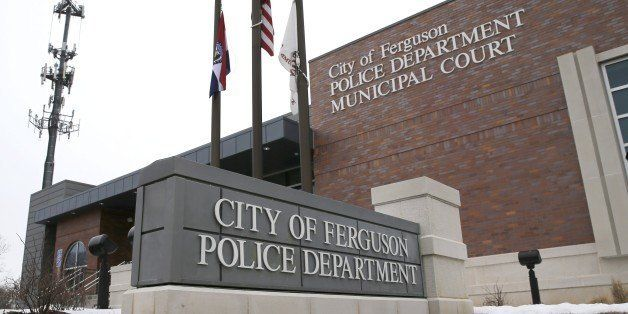 This photo taken Wednesday, March 4, 2015, shows the entrance to the Ferguson, Mo., Police Department. The Justice Department