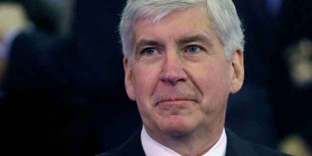FILE - In this Feb. 11, 2015 file photo, Michigan Gov. Rick Snyder gets ready for an address in Lansing, Mich. Snyder used hi